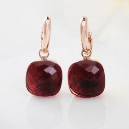 imitation pomellato inspired nudo earrings in pink gold with garnet