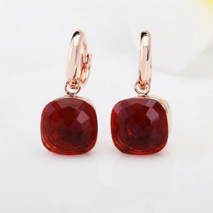 replica pomellato nudo earrings in pink gold with garnet