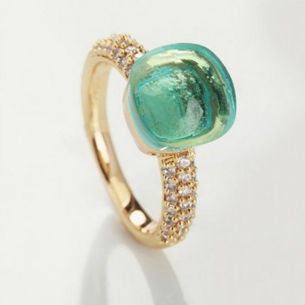 pomellato nudo ring in imitation yellow gold with blue topaz and diamonds