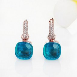 imitation pomellato earrings in rose gold with london blue topaz and diamonds